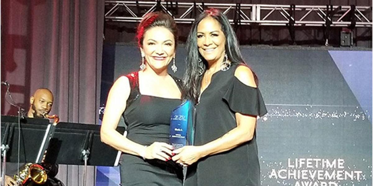 Nina Vaca presents the Lifetime Achievement Award to Sheila E.