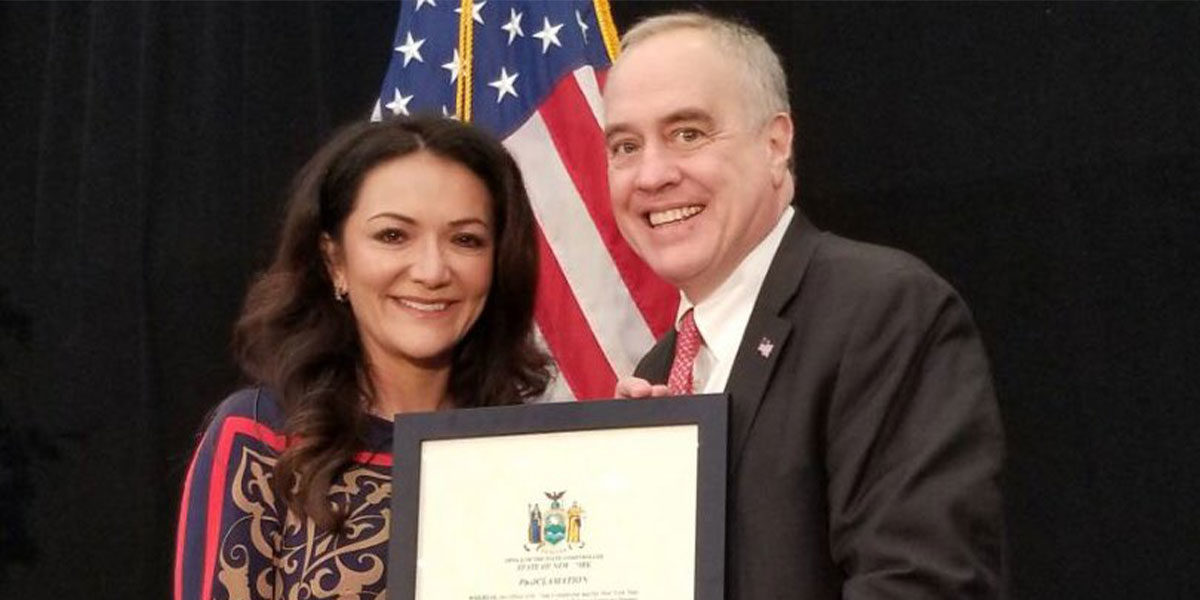 Nina Vaca receives proclamation from the State of New York